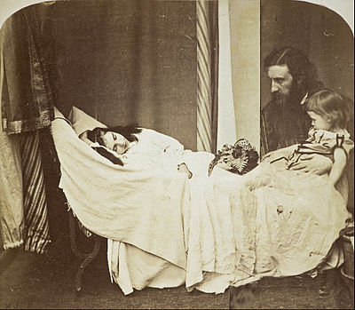 MacDonald with daughter Mary and son Ronald, ca. 1864. Photo by Lewis Carroll.