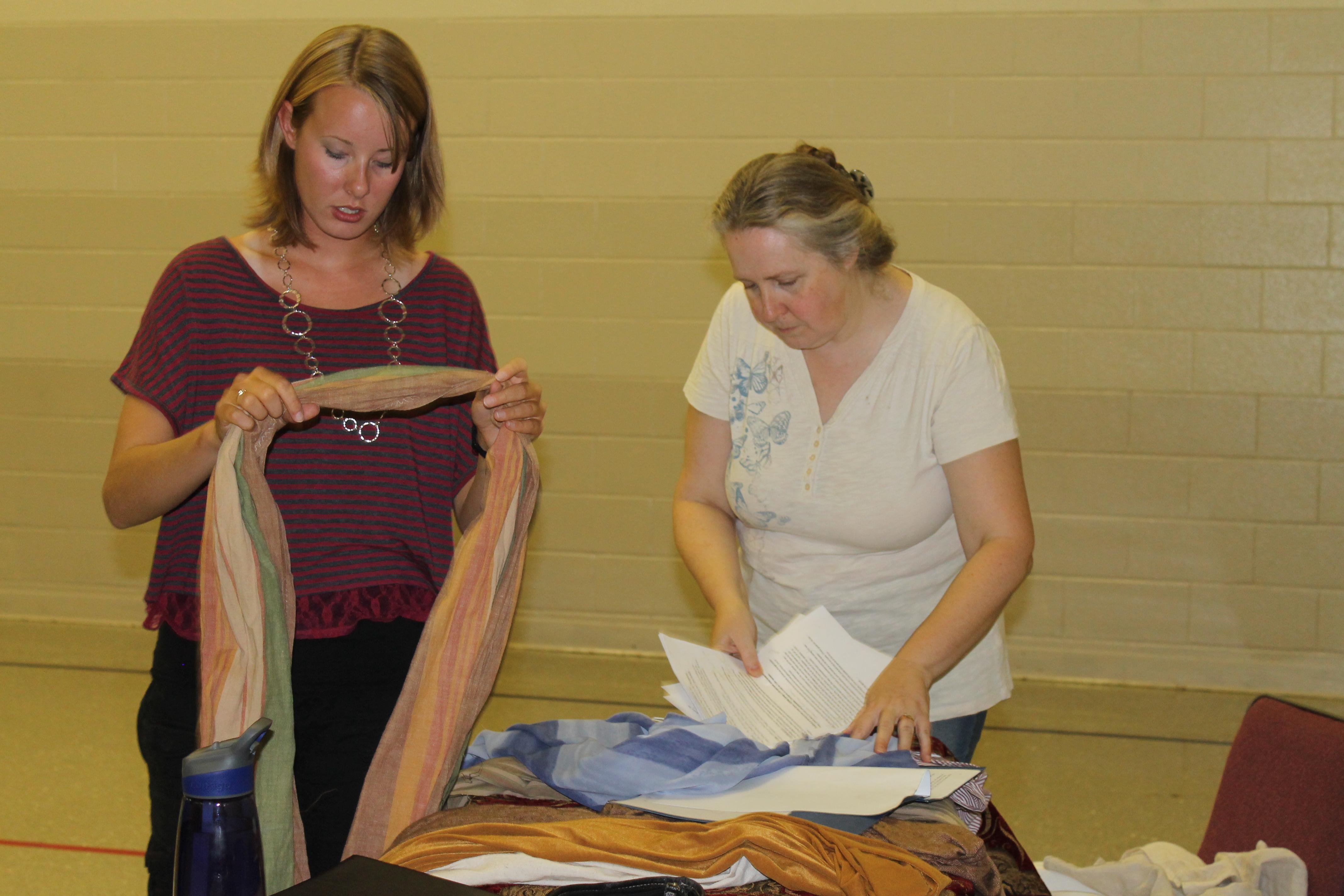Kayla & Lauren working on costumes.
