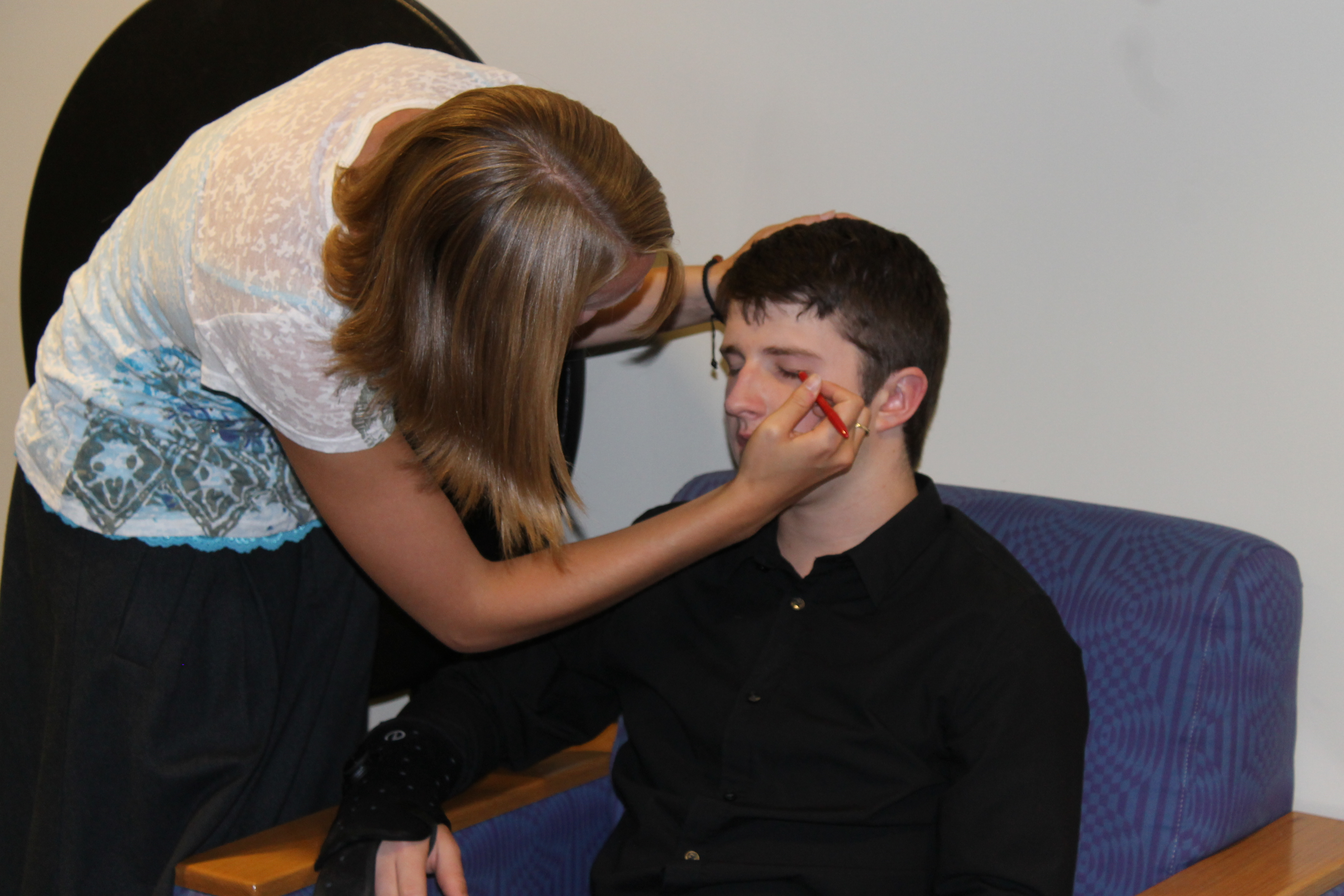 Kayla getting Matt Simon (Timothy) prepared to go on stage for dress rehearsal.